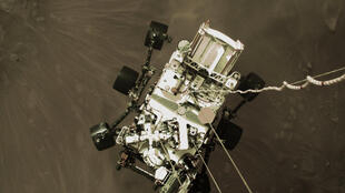 """The high-resolution still was extracted from a video taken by the descent stage, which at that moment had used its six-engined jetpack to slow to a speed of about 1.7 miles (2.7 kilometers) per hour as part of the """"skycrane maneuver"""""""