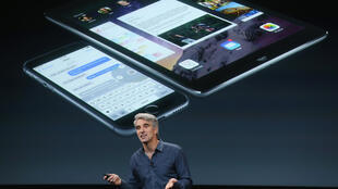 Apple's senior vice president of software engineering Craig Federighi unveils the new iPad Air 2 at the firm's headquarters in Cupertino, California.