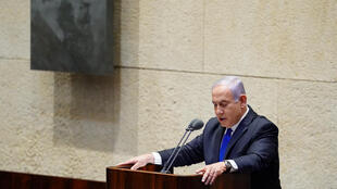 Israeli Prime Minister Benjamin Netanyahu speaks during a swearing-in ceremony of his new unity government with election rival Benny Gantz at the Knesset, Israel's parliament, in Jerusalem on May 17, 2020.