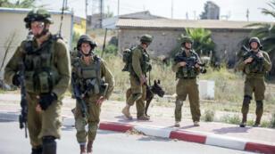Des soldats israéliens près de la frontière avec Gaza, le 21 juillet 2014.