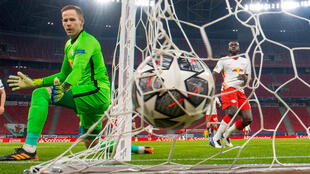 RB Leipzig goalkeeper Peter Gulacsi (L) has taken a stand against a law in his home country Hungary