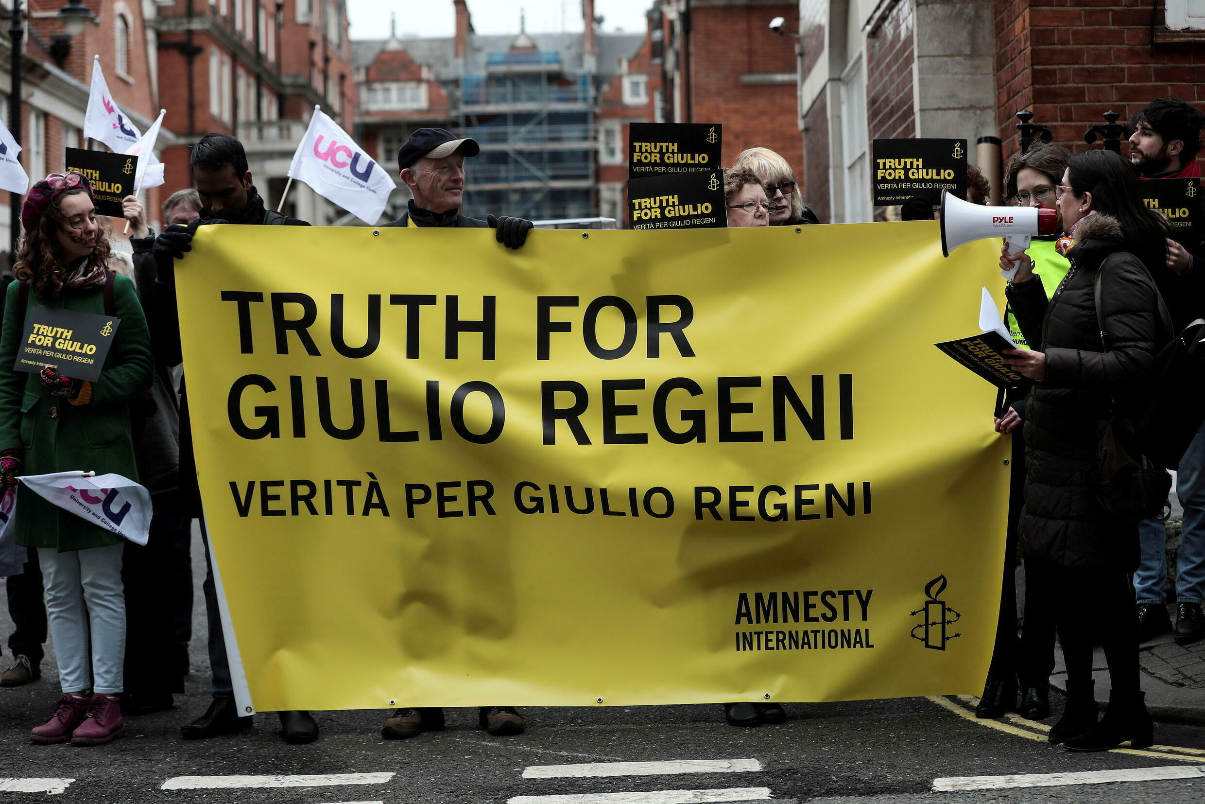 Demonstrators from Amnesty International hold placards outside the Egyptian embassy in London in support of Giulio Regeni, who was found murdered in Cairo in January 2016.