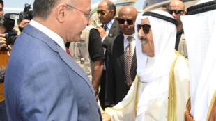 الرئيس العراقي برهم صالح مستقبلا امير الكويت الشيخ صباح الاحمد الصباح في بغداد في 19 حزيران/يونيو 2019
