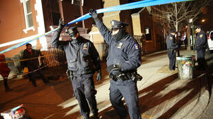 Police officers guard the crime scene on Saturday.