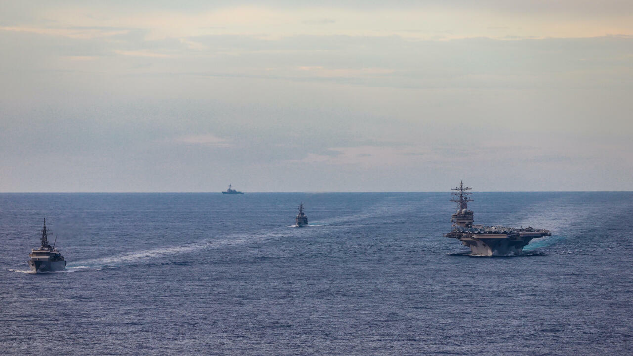 Japan Maritime Self-Defense Force training ships JS Kashima and JS Shimayuki conduct a passing exercise (PASSEX) with Nimitz-class nuclear-powered aircraft carrier USS Ronald Reagan in the South China Sea, July 7, 2020. Picture taken July 7, 2020.