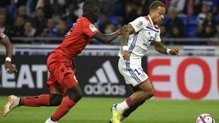 Lyon's Dutch forward Memphis Depay (R) was burgled during Friday's Ligue 1 match with Nice