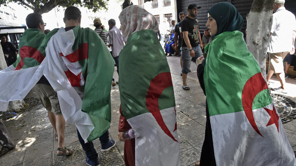 Algerians take to the streets once more, pledging civil disobedience