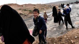 Des familles irakiennes fuyant les combats de Mossoul le 3 mars 2017.