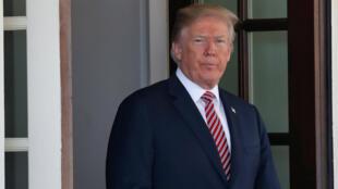 El presidente de Estados Unidos, Donald Trump, recibe al emir catarí Hamad bin Khalifa Al-Thani en la Casa Blanca, en Washington, el 10 de abril de 2018.
