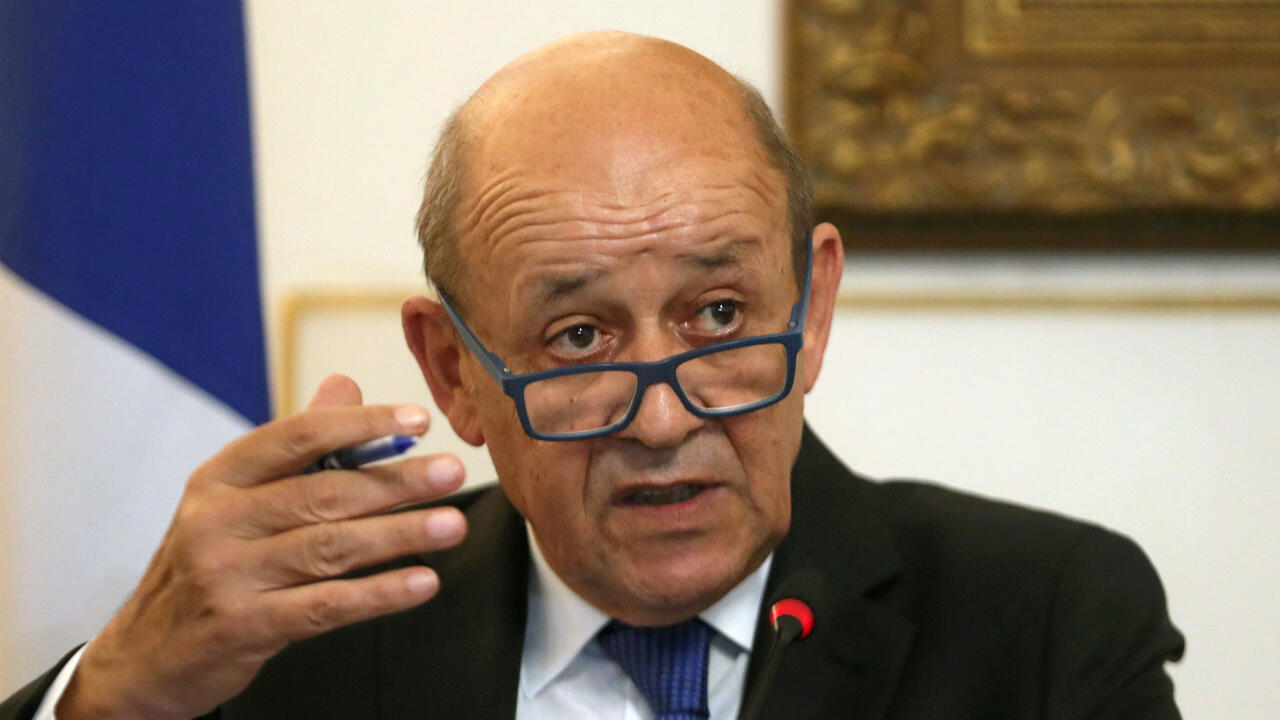 French Foreign Minister Jean-Yves Le Drian has called on the US to withdraw sanctions targeting ICC staff investigating the US campaign in Afghanistan.
