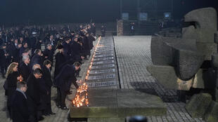 A delegation made up of heads of state and survivors attend a candle lighting ceremony at the former German Nazi death camp Auschwitz-Birkenau during events to commemorate the 75th anniversary of the camp's liberation in Oswiecim, Poland, on January 27, 2020.
