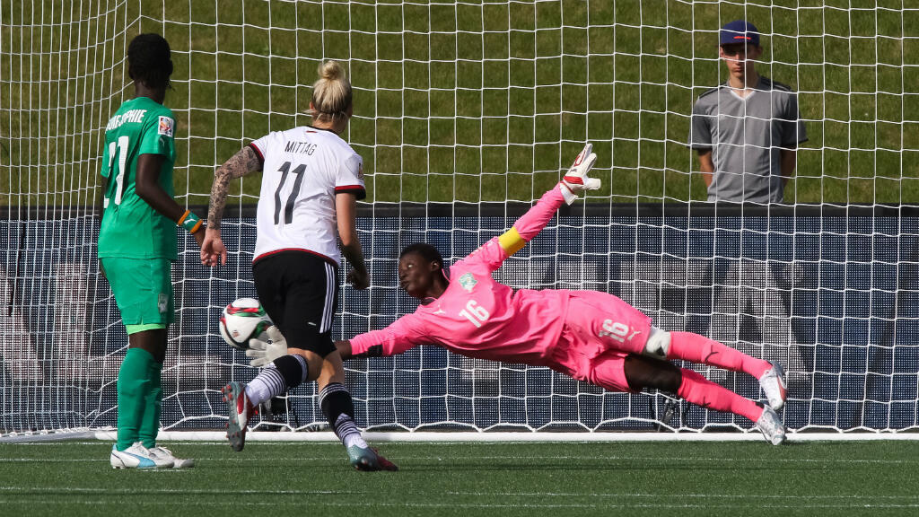 Ivory Coast goalkeeper Dominique Thiamale is beaten by a shot during her side's 10-0 defeat to Germany at Lansdowne Stadium in Ottawa on June 7, 2015