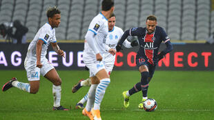 PSG's Brazilian striker Neymar runs with the ball during the French Champions Trophy match against Marseille at the Bollaert-Delelis Stadium in Lens, January 13, 2021.