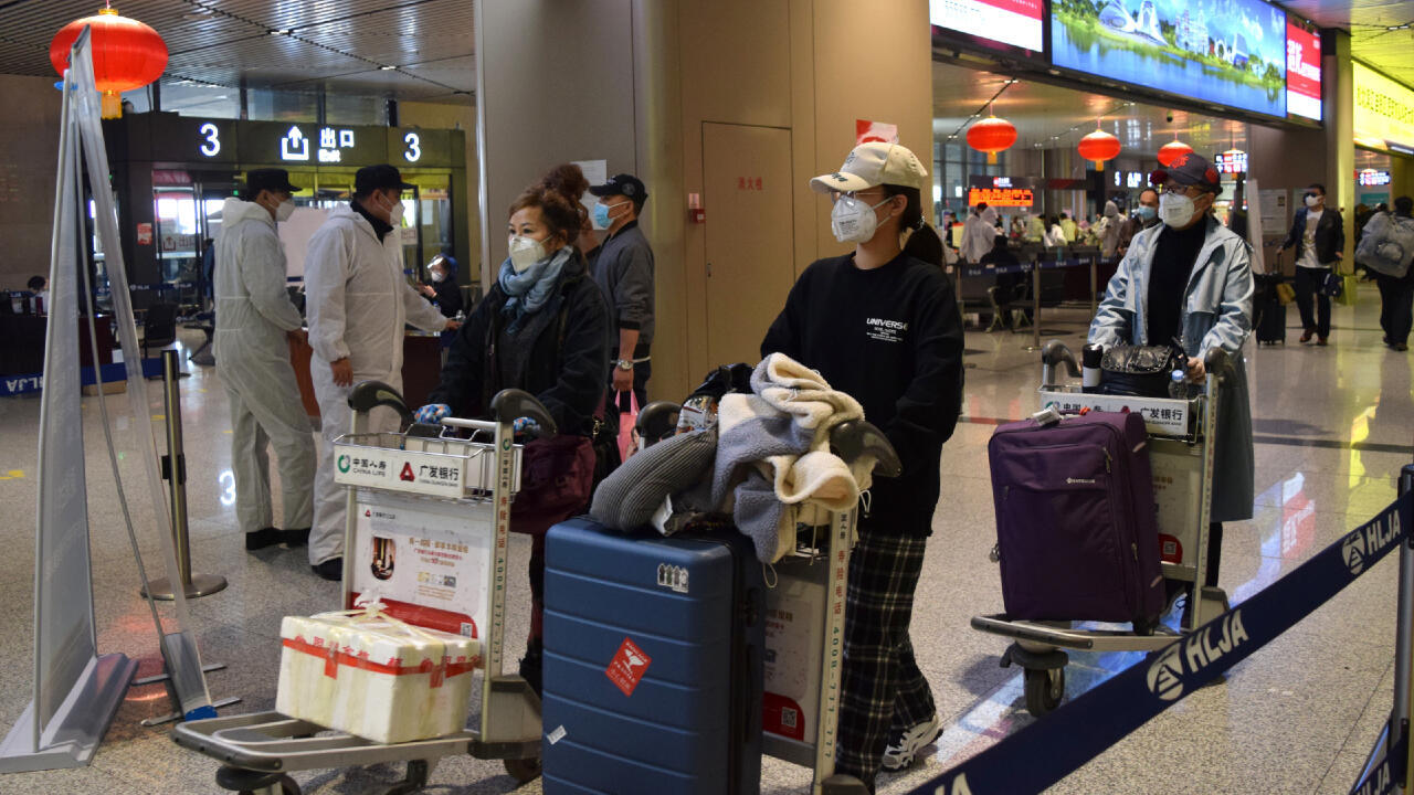 Passengers wearing face masks push luggage carts at an airport in Harbin, capital of Heilongjiang province bordering Russia, as the spread of the novel coronavirus disease (COVID-19) continues in the country, China April 11, 2020.