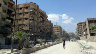 صورة نشرتها وكالة سانا لمدنيين في الغوطة الشرقية في 14 نيسان/أبريل 2018