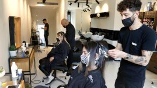 Israelis have begun returning to hair salons after a tough third lockdown