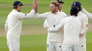 England's Ben Stokes (centre) celebrates after taking the wicket of West Indies batsman Jermaine Blackwood