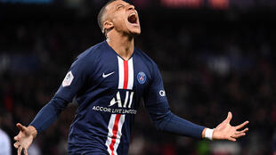 Paris Saint-Germain's French forward Kylian Mbappe celebrates after scoring a goal during the French L1 football match between Paris Saint-Germain (PSG) and Dijon, on February 29, 2020 at the Parc des Princes stadium in Paris.