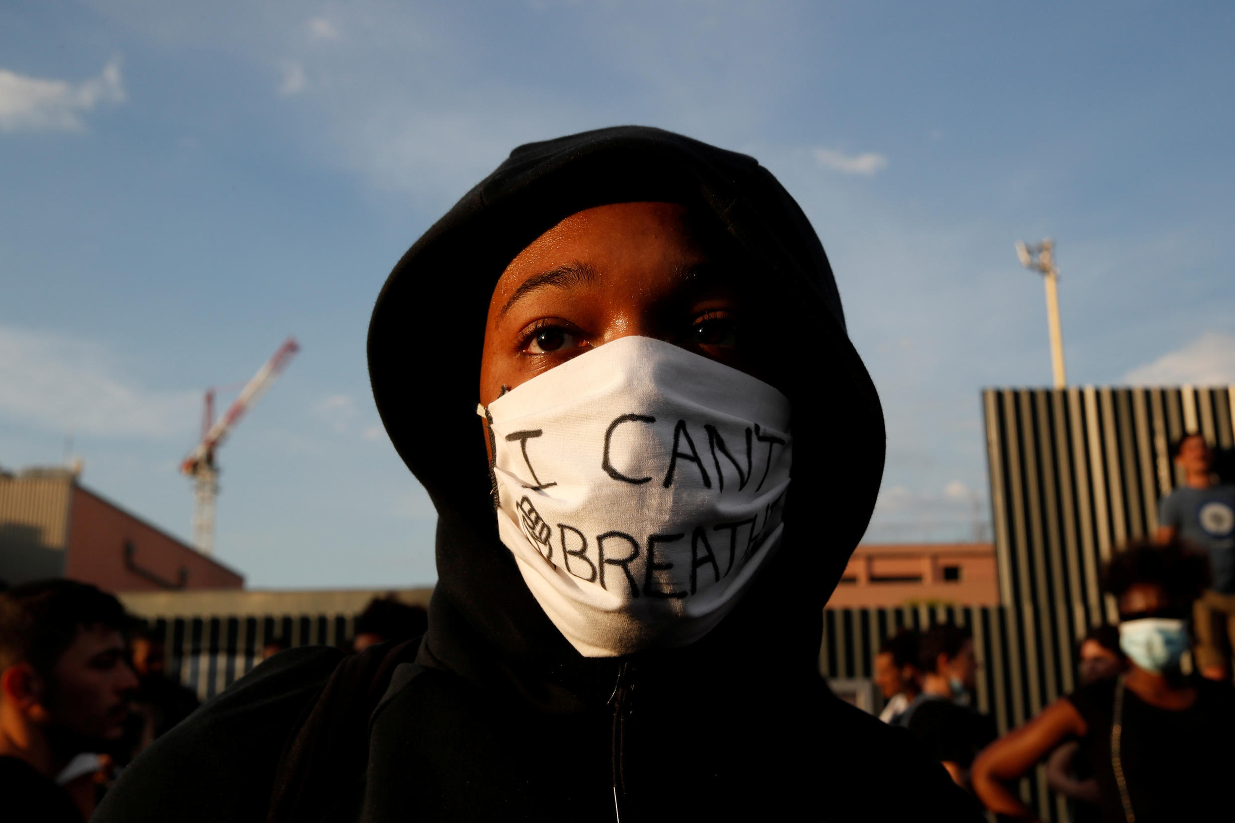 "A protester wears a protective mask reading ""I can't breathe"" at a rally in Paris on June 2, 2020."