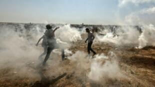 قتل على الأقل 129 فلسطينيا خلال المظاهرات على الحدود بين قطاع غزة وإسرائيل في حزيران/يونيو 2018