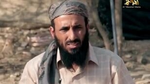 A screen grab taken in March 2014 by Al-Malahem Media, the media arm of al Qaeda in the Arabian Peninsula shows leader Nasser al-Wuhayshi at an undisclosed location in Yemen.