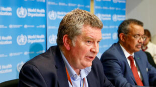In this photo from February 6, the executive director of the World Health Organization's (WHO) emergencies program Mike Ryan, sitting next to WHO chief Tedros Adhanom Ghebreyesus, speaks at a news conference on the novel coronavirus in Geneva, Switzerland.