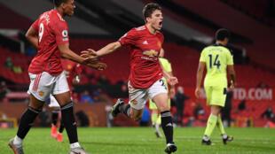 Dan the man: Daniel James (centre)celebrates scoring Manchester United's second goal