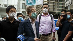 Former lawmaker and pro-democracy activist Martin Lee (centre L) talks to members of the media as he leaves the Central District police station in Hong Kong on April 18, 2020, after being arrested and accused of organising and taking part in an unlawful assembly in August last year. Police in Hong Kong carried out a sweeping operation against high-profile democracy campaigners on April 18, arresting 14 activists on charges related to massive protests that rocked the Asian financial hub last year.