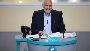 Former vice president Mohsen Mehralizadeh, seen here taking part in a televised debate last week, has pulled out of the race for Friday's Iranian presidential election, leaving just one reformist in the field