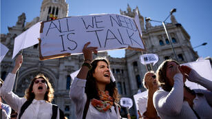"Protesters attend a demonstration called by the ""Let's talk"" (Parlem, Hablemos) association for dialogue in Catalonia in October 07, 2017 at Cibeles square in Madrid."