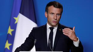 French President Emmanuel Macron speaks at a press conference at the end of the first day of the EU Summit in Brussels, Belgium, October 2, 2020.