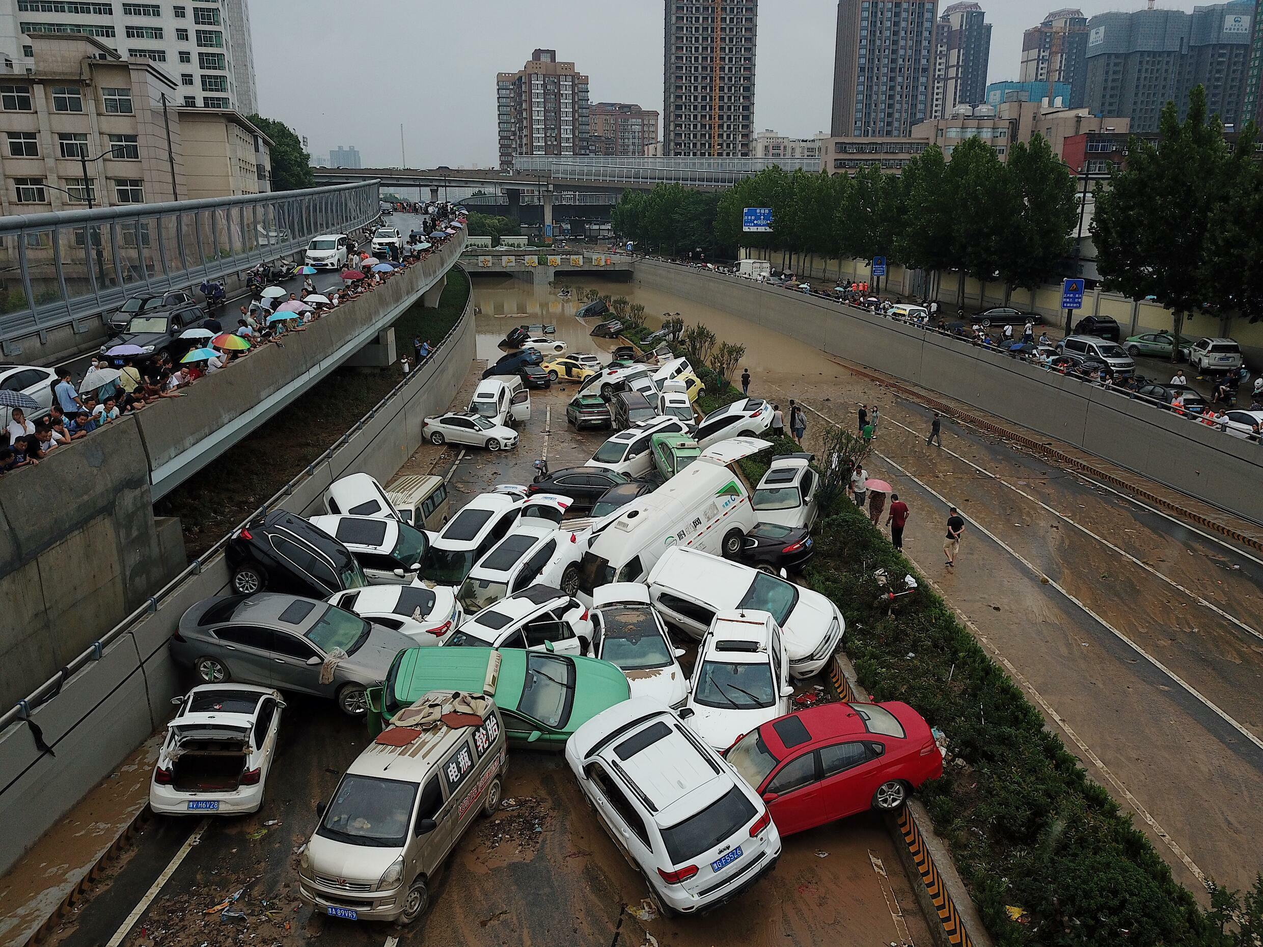 Cars were strewn over roads after the heavy rains hit the city of Zhengzhou