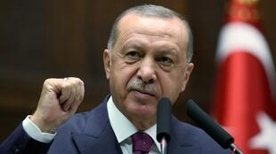 Turkish President Tayyip Erdogan addresses lawmakers from of his ruling AK Party