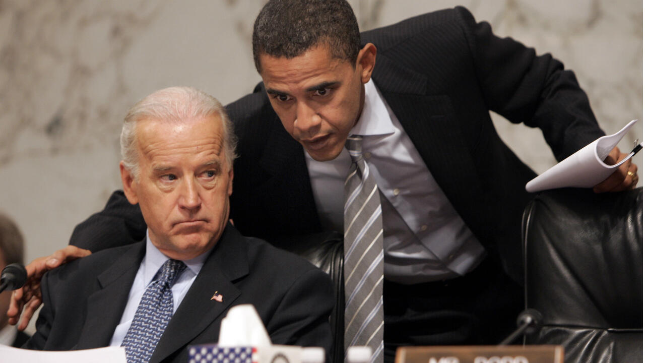 Then-Democratic presidential hopeful, Sen. Barack Obama, D-Ill., right, huddles with then-Senate Foreign Relations Committee Chairman Sen. Joe Biden, D-Del., left, on Capitol Hill in Washington during the committee's hearing on Iraq on January 31, 2007.