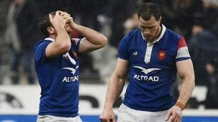 France's fly half Camille Lopez holds his head in his hands against England