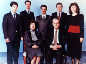 A 1985 Assad family photograph shows in the front, former Syrian president, Hafez al-Assad, and his wife, Anisa. The children in the back row, from left to right, are Maher, current Syrian President Bashar al-Assad, Basil, Majid, and Bushra.