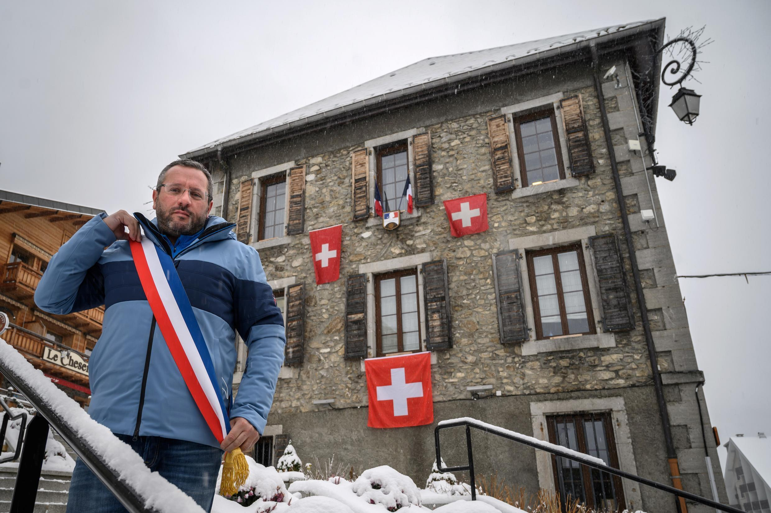 Nicolas Rubin, the mayor of Châtel, has draped his town hall in Swiss flags in protest at France's decision to close ski lifts while resorts across the border remain open.