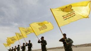 عناصر من قوات سوريا الديمقراطية في استعراض عسكري