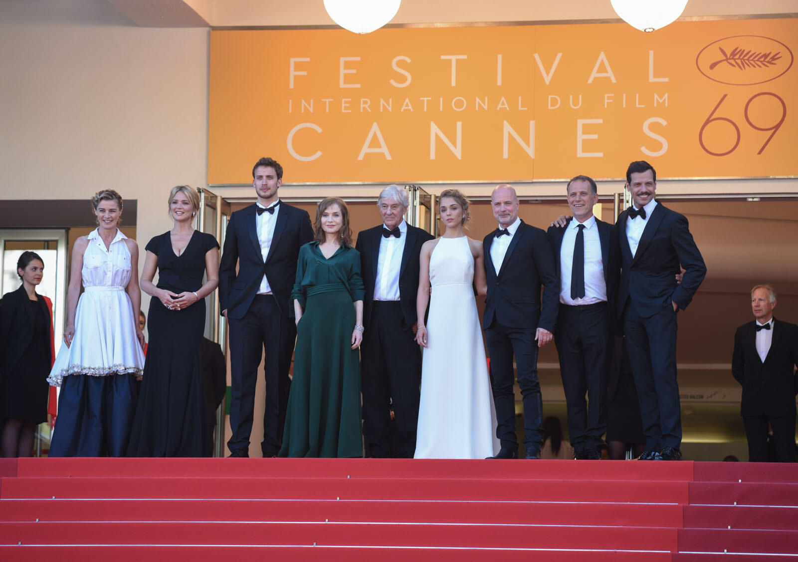 "The director and cast of ""Elle"" pose at the top of the Cannes steps. The movie, the first French offering from director Paul Verhoeven, is a serious contender for the coveted Palme d'Or, according to FRANCE 24's film critics."