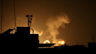 Flame and smoke are seen during Israeli air strikes in the southern Gaza Strip, February 23, 2020.