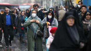 Women in Tehran with masks on February 20, 2020.