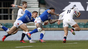 Jonny May (R) scored one of six England tries in their Six Nations victory over Italy