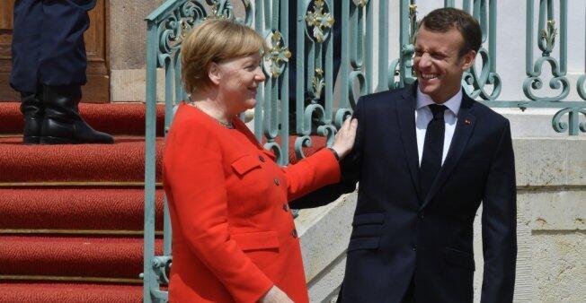 الرئيس الفرنسي إيمانويل ماكرون والمستشارة الألمانية أنغيلا ميركل.