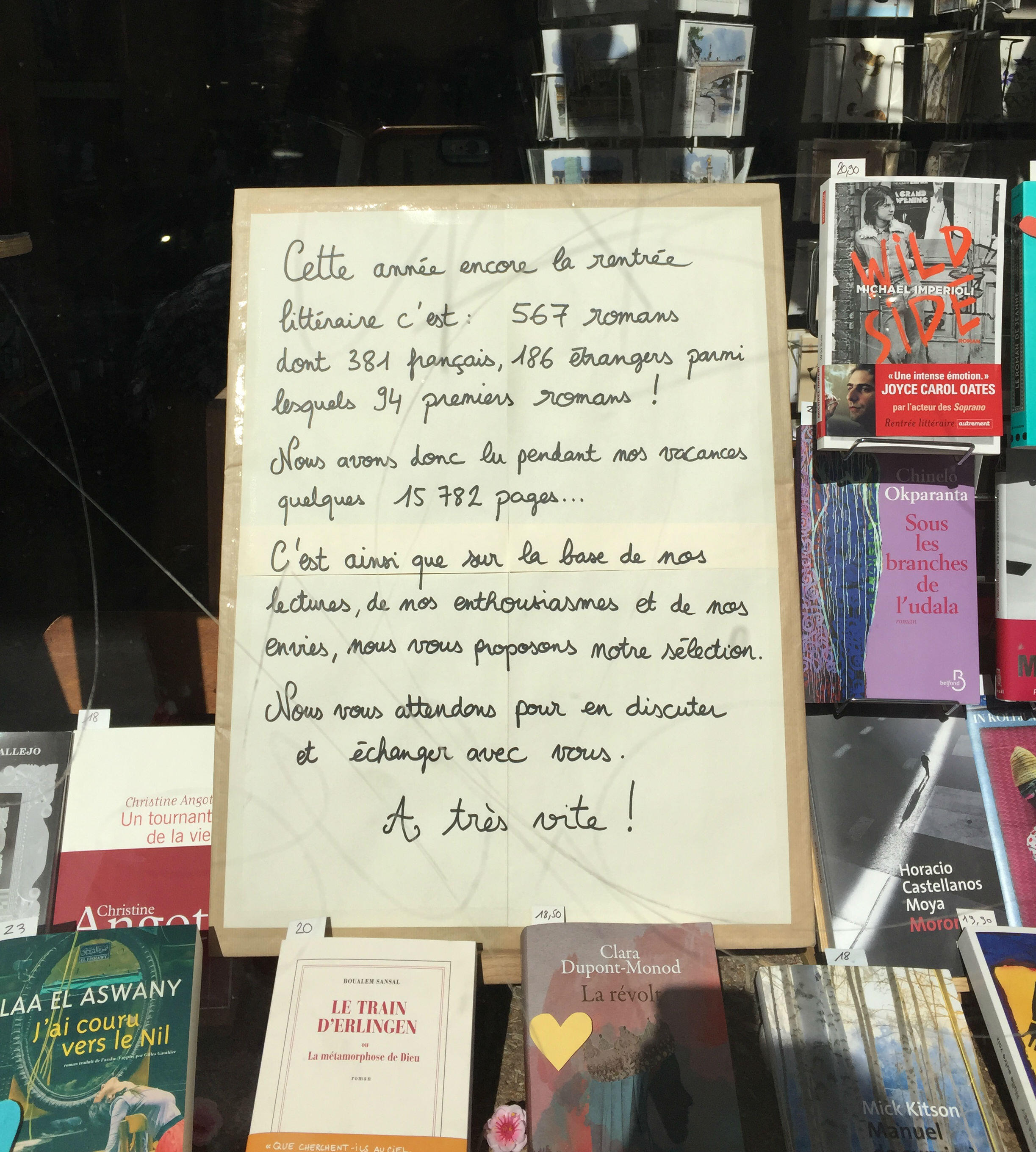"This book shop sign for the rentrée reads: ""This year, the rentrée littéraire is: 567 novels -- 381 french, 186 foreign -- among whom 94 are first novels! So during our holidays, we read some 15,782 pages... We look forward to discussing and sharing them with you!"""