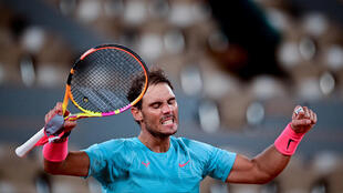 Spain's Rafael Nadal celebrates after winning against Italy's Jannik Sinner at the end of their men's singles quarter-final tennis match on Day 10 of The Roland Garros 2020 French Open tennis tournament in Paris on October 6, 2020.