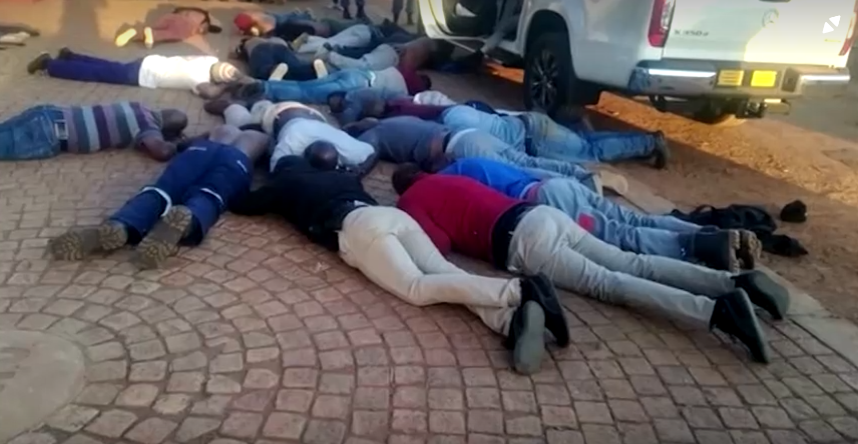 40 people were arrested, including police officers, when an armed group stormed the International Pentecostal Holiness Church in Zuurbekom, South Africa, July 11 2020.