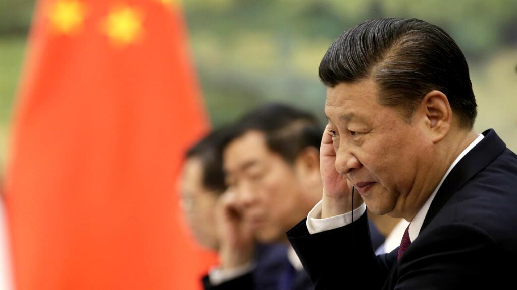 """Xi Jinping a fait part mardi de sa volonté de """"défendre"""" avec la France l'accord de Paris sur le climat."""