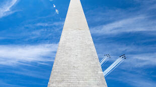 The US Navy Blue Angels (R) and US Air Force Thunderbirds fly past the Washington Monument on May 2, 2020, in a tribute to frontline workers during the coronavirus pandemic