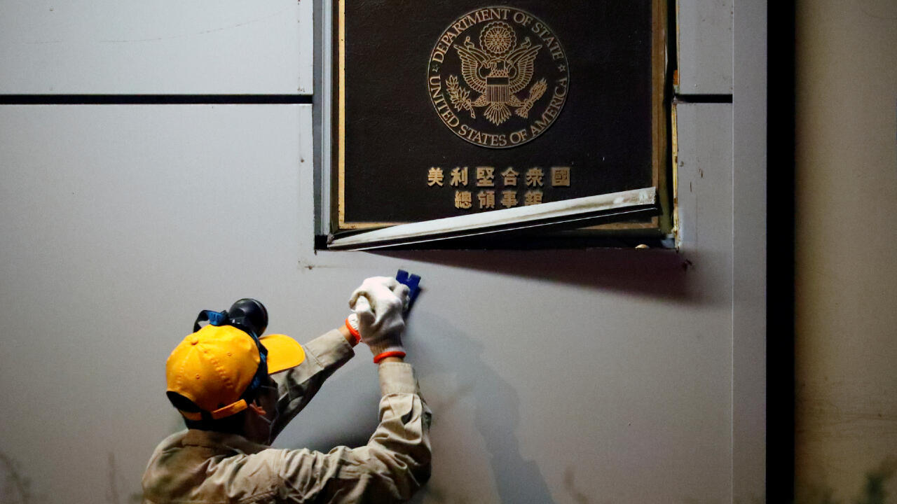 A man works to remove the U.S. Consulate plaque at the U.S. Consulate General in Chengdu, Sichuan province, China, July 26, 2020.