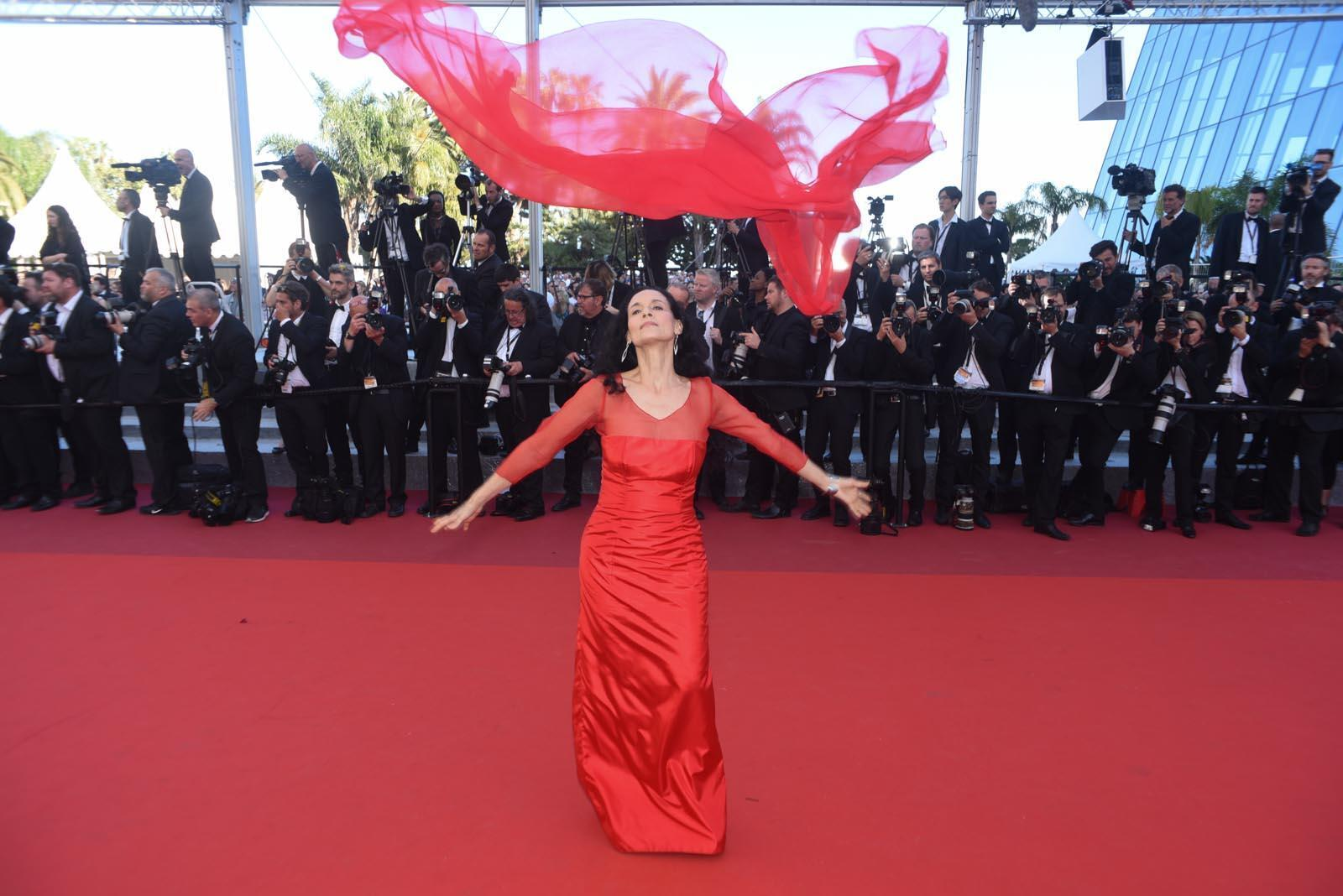 "Brazilian actress Sonia Braga, one of the top contenders for the best actress award for her role in ""Aquarius"", plays with her scarf on the red carpet."